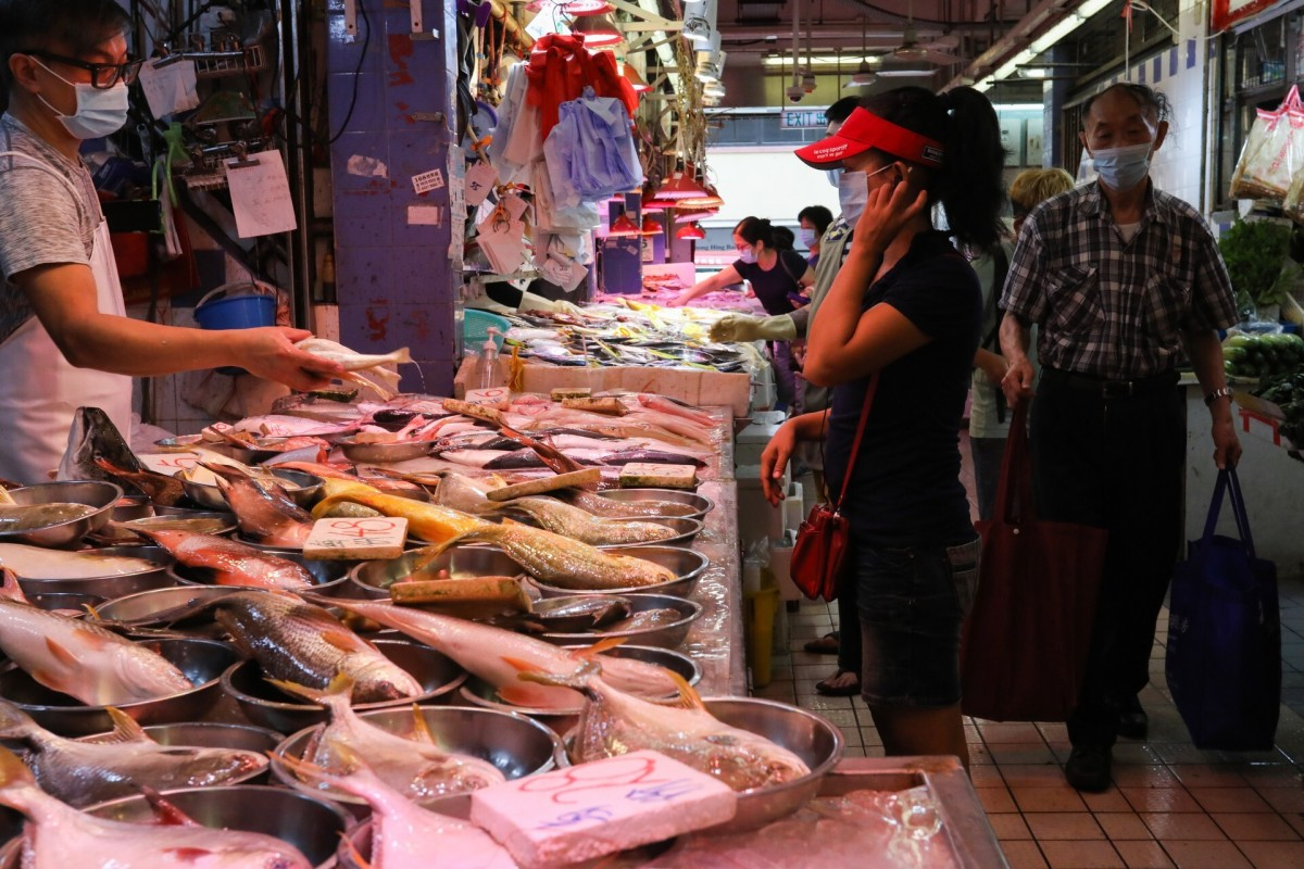 A shopper stops at a fish stall in Kowloon City Market on Wednesday. Photo: Nora Tam
