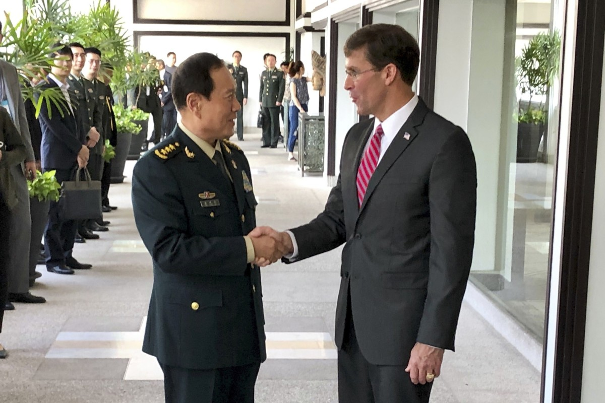 Chinese Defence Minister Wei Fenghe, left, greets US Defence Secretary Mark Esper in Bangkok, Thailand in November 2019. Photo: AP