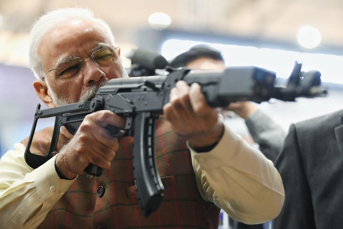 Indian Prime Minister Narendra Modi holds a rifle during a defence expo in February. The country is looking to import military equipment amid tensions with its neighbours, despite plans to boost its own defence industry. Photo: AP