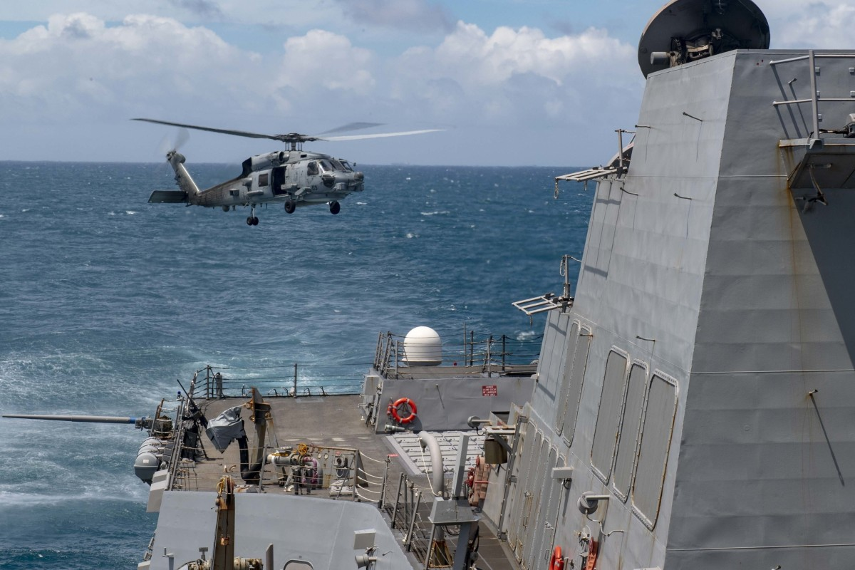 An MH-60R helicopter takes off from the flight deck of the USS Mustin during routine operations. Photo: US Navy
