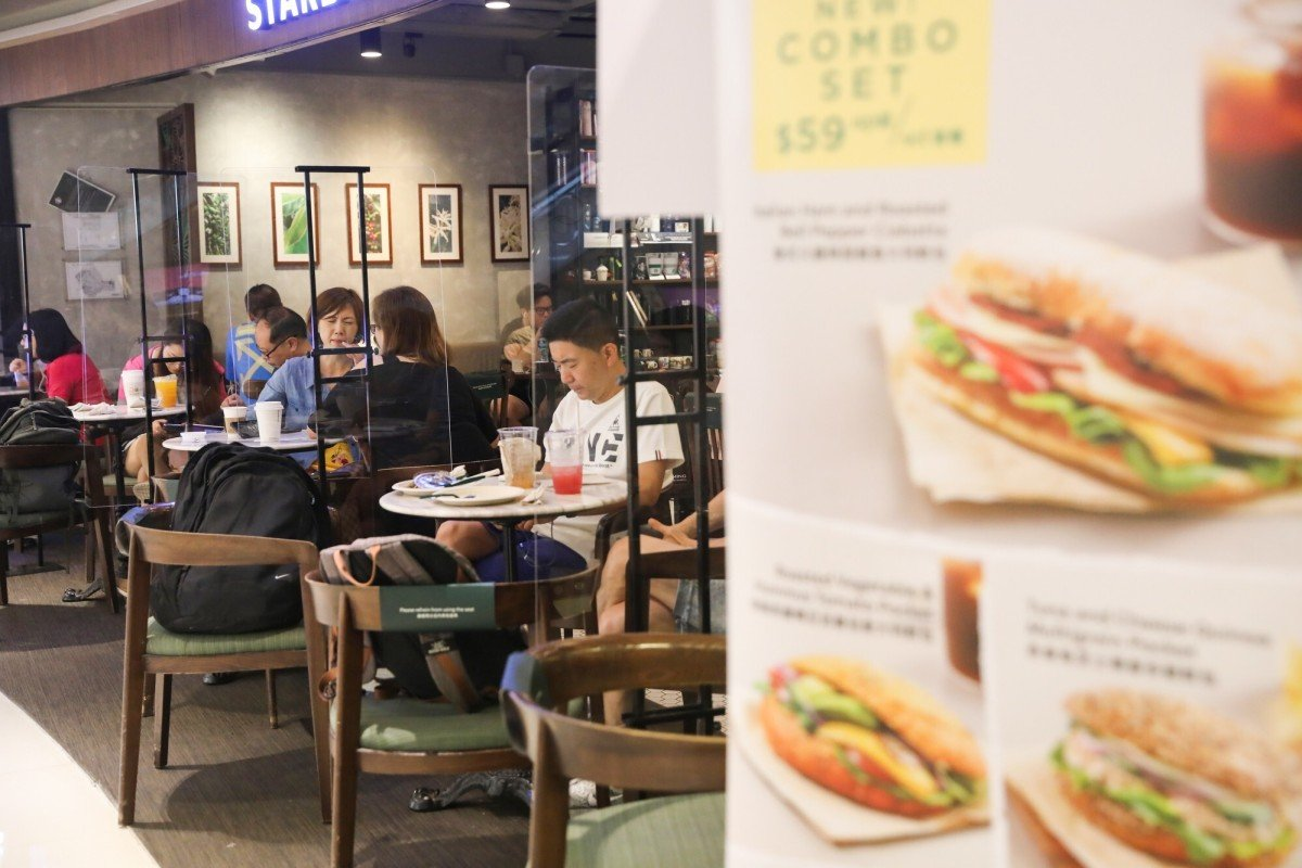 The number of people allowed to sit together at restaurants in Hong Kong will rise to four from Friday. Photo: K.Y. Cheng