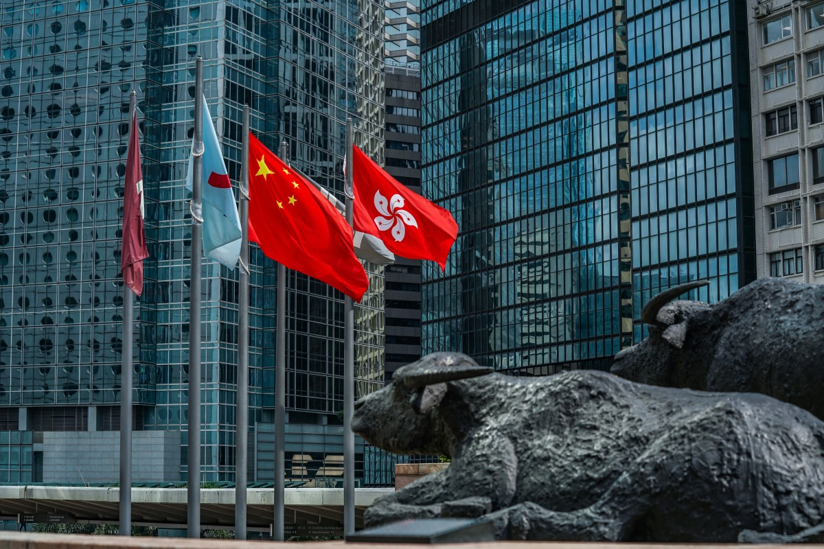 The flags of China and Hong Kong fly outside Exchange Square, which houses the Hong Kong stock exchange, on May 29. Photo: Bloomberg