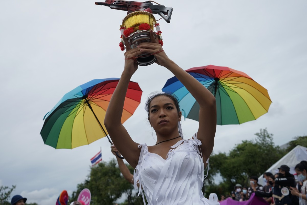 Angele Anang holds a bowl with a machine gun representing the military's grip on power. Photo: Handout
