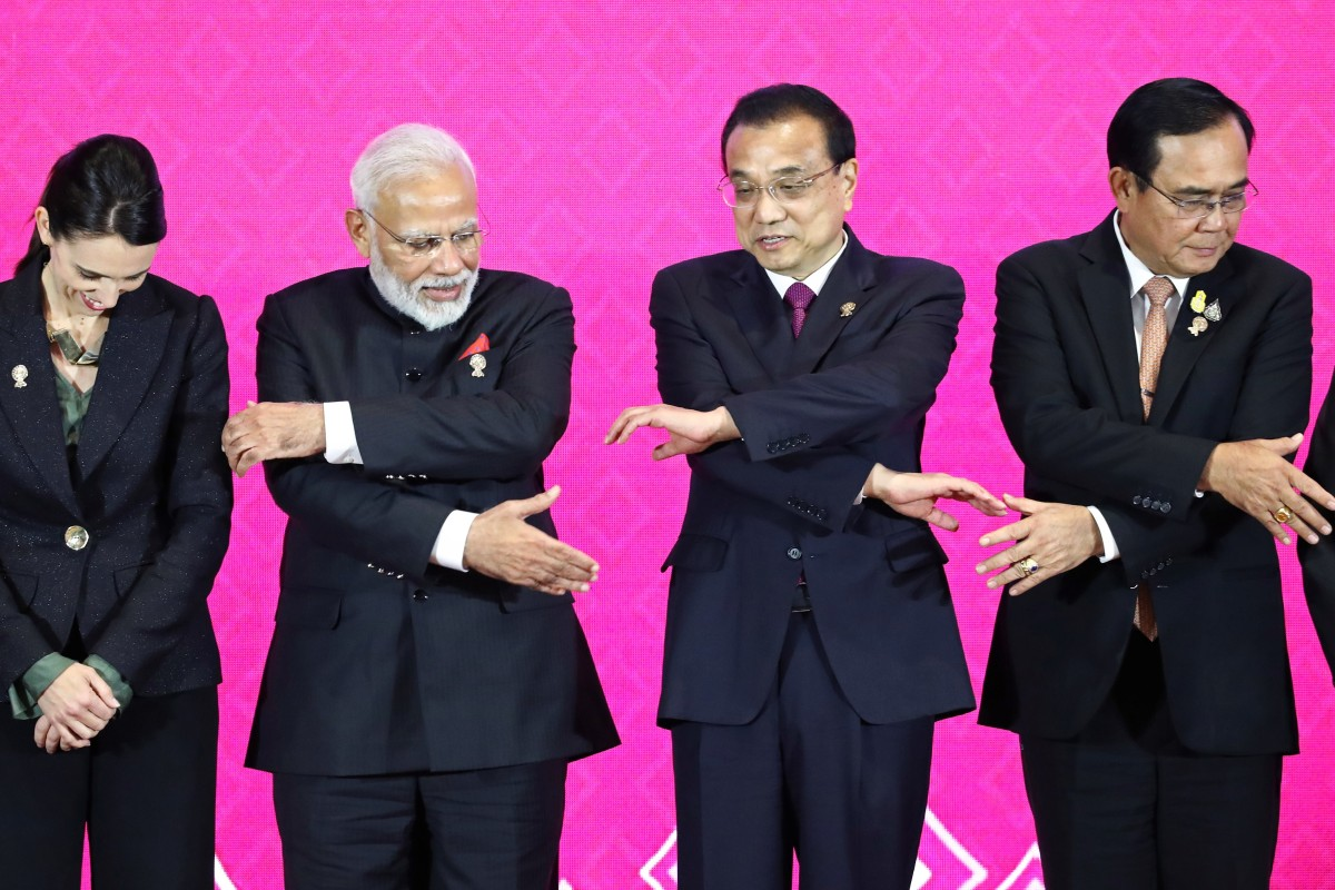 Chinese Premier Li Keqiang (second right) locks hands with other leaders at the RCEP summit in Bangkok in November last year. Photo: Reuters
