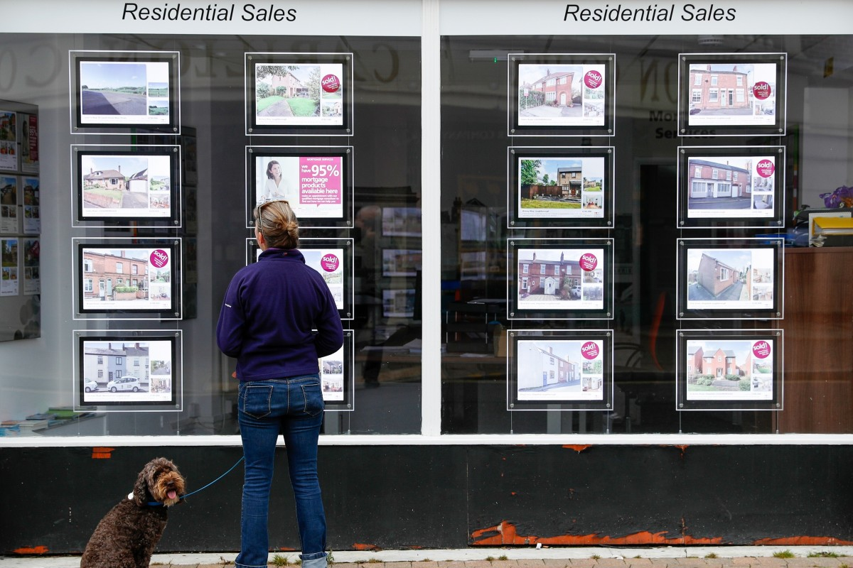 Residential sales in the window of an property agent in Loughborough in the United Kingdom on Monday, July 5, 2021. Photo: Bloomberg.