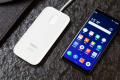 Meizu calls this the world's first holeless phone (right). (Picture: Meizu via Weibo)