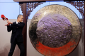 Wang hitting the Chinese gong at the Hong Kong Stock Exchange. (Picture: Reuters)