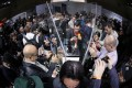 MWC attendees jostling for a snap of the Huawei Mate X bendable phone. (Picture: Bloomberg)