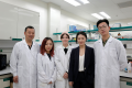 Dr Kelsey Zhongling, deputy executive director of ImmunoDiagnostics (second from right), and the company's research team