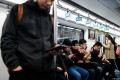Commuters on a subway in Beijing on April 8, 2019. (Picture: Wang Zhao / AFP)