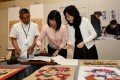 Demonstration of Yangjiabu Woodblock Prints of New Year Paintings: Zhao Xintian (right), deputy curator of the Shandong Provincial Cultural Center, and Yang Naidong (left), an intangible cultural heritage bearer of Yangjiabu woodblock prints of New Year Paintings, introducing the art to Michelle Li (centre), Director of Leisure and Cultural Services.