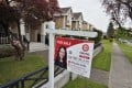 """A """"for sale"""" sign outside a Vancouver home being marketed by Kathy Xu, a director of Maxcel Westcoast Realty. Photo: Ian Young"""