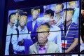 Facial recognition cameras now standard in China's southern tech hub of Shenzhen. Here Chinese AI company Megvii shows off its facial recognition at a Shenzhen security expo. (Picture: Bobby Yip/Reuters)