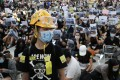 Black T-shirts, helmets and masks are a common sight among Hong Kong protesters. (Picture: Edmond So/SCMP)