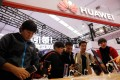 Visitors trying out Huawei's 5G phones during the World 5G Convention in Beijing on November 21, 2019. (Picture: Wu Hong/EPA-EFE)