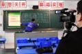 A teacher gives an online class for students at a high school in Zhengzhou, Henan province, on February 2. (Picture: Li Jianan/Xinhua)