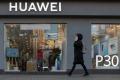 A woman walks past a Huawei store in central Kiev, Ukraine, on November 11, 2019. (Picture: Valentyn Ogirenko/Reuters)