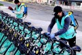 Hellobike, Qingju Bike and Meituan launched a campaign for their staff to disinfect all shared bikes on the streets daily, no matter the brand. (Picture: Didi)