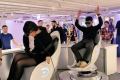 People trying out VR goggles at Huawei's new flagship store in France. (Picture: Huawei via Twitter)