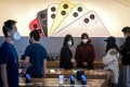Staff and customers wearing face masks at an Apple Store in Beijing on February 22. (Picture: AFP)