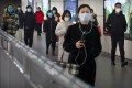 Passengers with face masks on in a Beijing subway station on March 6. (Picture: AP)