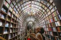 A girl looks up at the ceiling at a newly opened bookstore in Beijing on July 19, 2019. (Picture: Simon Song/SCMP)