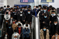 Passengers inside a subway station during morning rush hour in Beijing on April 7. Apple Pay has been available on public transport in the capital and Shanghai since 2018. (Picture: Tingshu Wang/Reuters)