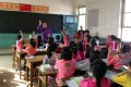 A counselor in China teaches students how to protect their bodies on October 15, 2013. (Picture: South China Morning Post)