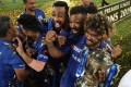 Mumbai Indians celebrate their win in the final cricket match of the Indian Premier League in 2019 with a trophy decorated with Vivo-branded ribbons. (Picture: Mahesh Kumar A./AP Photo)