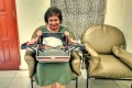 Mortuary make-up beautician Gloria Elsa Hutasoit at home with her beauty tool case. Photo: Sylviana Hamdani