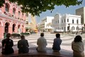 Residents of Macau spend a leisurely afternoon in Senado Square. Photo: AP