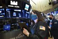 A trader works on the floor of the New York Stock Exchange on March 10 when stability in the bond market translated into gains for stocks. Photo: AP