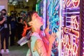 A model poses with a neon display at Heart of Cyberpunk, a multidisciplinary fashion and design event, in Sham Shui Po in October 2020. Photo: Design District Hong Kong
