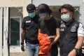 Thai police arrest Danudetch. Photo: DSI