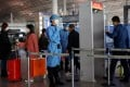 Medical staff check people's temperature as they enter Beijing's international airport on November 5, 2020. Photo: Reuters