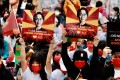 Myanmar nationals in Taiwan display portraits of ousted leader Aung San Suu Kyi during a protest. Photo: AFP