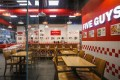 US burger chain Five Guys opened its first Hong Kong outlet in Wan Chai in 2018. Photo: Xiaomei Chen