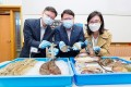 (From left) Professor Qiu Jianwen, Professor Kenneth Leung and Dr Lily Tao display fish commonly found in Hong Kong waters. Photo: City University