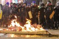 Protesters set fire to a barricade designed to block a section of Nathan Road, in Mong Kok. Photo: Felix Wong