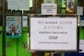 A sign informs residents that vaccinations using BioNTech jabs have been suspended. Photo: May Tse