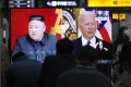 Commuters in Seoul watch a television showing a file image of North Korean leader Kim Jong-un and US President Joe Biden on March 26. Photo: AP