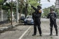 Indonesian armed police pictured near the site of the explosion in Makassar on Sunday. Photo: Zuma wire/DPA