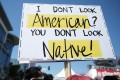 A demonstrator holds a sign at the Stop Asian Hate rally in Koreatown, Los Angeles on Saturday. Photo: Getty Images / AFP