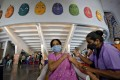 A woman receives a dose of Covishield, a Covid-19 vaccine manufactured by Serum Institute of India, at an auditorium which has been converted into a temporary vaccination centre, in Ahmedabad, India, on March 26. The Quad is looking to boost India's vaccine diplomacy to counter China's influence in the region. Photo: Reuters