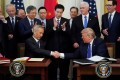Chinese Vice-Premier Liu He and US President Donald Trump after signing phase one of the US-China trade agreement during a ceremony at the White House on January 15, 2020. Photo: Reuters