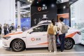 Attendees look at a Didi Chuxing autonomous vehicle at the World Artificial Intelligence Conference (WAIC) in Shanghai, China, on August 29, 2019. Photo: Bloomberg