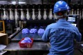 An employee works at a production line in Top Glove factory in Shah Alam, Malaysia. File photo: Reuters