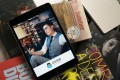 A welcome screen for the QQ Reading app, operated by China Literature, is displayed on an iPad Mini. Photo: Bloomberg
