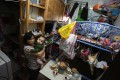 Ho Mei-ying lives with her eight-month-old son Zhang Hoi-shun and two other family members in a 100 sq ft subdivided flat in Cheung Sha Wan. Photo: Jonathan Wong