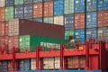 A worker secures stacked containers on a ship at the Kwai Tsing Container Terminals in Hong Kong on Monday. Photo: EPA-EFE